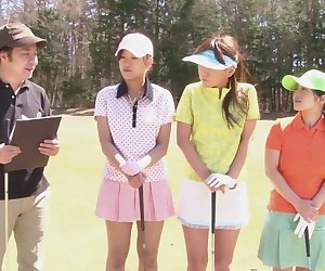 Cute Asian teen girls play a game of strip golf
