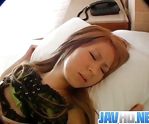 Young doll, Hitomi, bends for a long dick