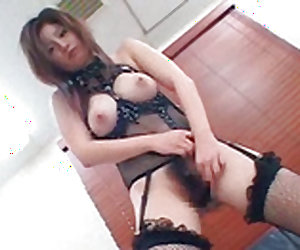 Japanese cutie with big tits is doing titjob on her knees