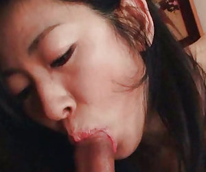 Asian shows off her cocksucking skills Video 4